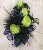 Mini jade roses with navy blue trim accented with peacock feathers