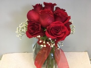 Red Roses Clustered together in Vase