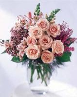 Pink sweetheart roses in vase