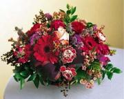 Basket arrangement with red flowers