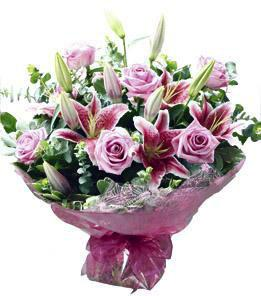 Roses and lilies hand tied