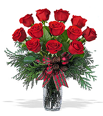 Order one dozen red roses in a contemporary clear vase for delivery in the Greater Grand Rapids Area by local florist, Sunnyslope Floral