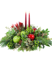 Winter theme centerpiece with red candles and fresh evergreen for GRAND RAPIDS area deliveries today by local flower shop, Sunnyslope Floral