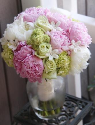 Peony, hydrangea, stephanotis & roses in a hand tied