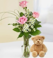 Pink Rose Bud Vase and a Teddy Bear