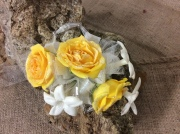 Yellow rose, white stephanotis Corsage
