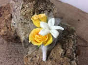 Yellow rose, white stephanotis Boutonniere