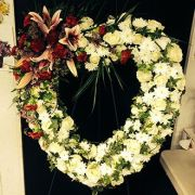 Sympathy Wreath of white roses with stargazer lilies