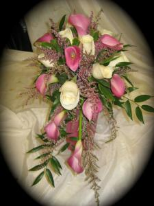 BOUQUET INCLUDES CALLAS , ROSES AND HEATHER