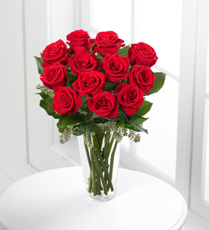 Order a dozen long stem red roses for same day delivery by your local and worldwide flower delivery specialists in Grand Rapids, Sunnyslope Floral