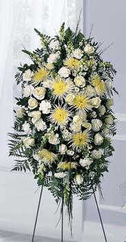 Yellow and white standing spray and other sympathy fresh flower arrangements delivered in Grand Rapids, Holland and Byron Center with Sunnyslope Floral