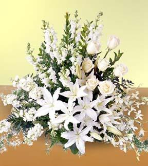 White lily sympathy spray and other sympathy gift ideas for delivery to Reyers, Heritage Life Story, Cook and Pederson funeral homes by Sunnyslope Floral