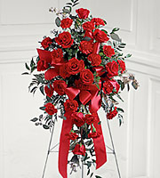 Red rose and red carnation spray on an easel for delivery to funeral homes in Grand Rapids, Byron Center, Rockford and Holland with Sunnyslope Floral