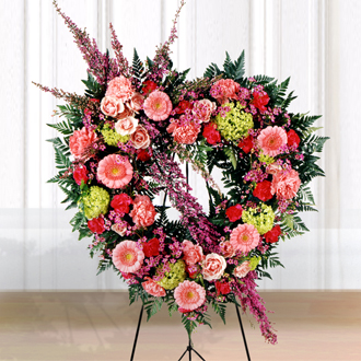 Order heart shaped sympathy wreaths & other fresh flower sympathy gift ideas for same day delivery in Grand Rapids & nation wide with Sunnyslope Floral