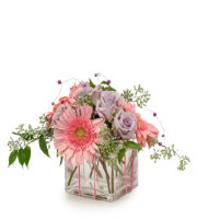 Send PRETTY PINK AND PURPLE Simple FLORAL Arrangement short vase to Ada, Holland, Grand Rapids, and more by Sunnyslope Floral