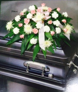 Sympathy pink and white casket spray