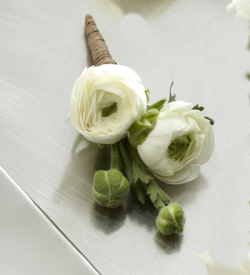 The FTD® White Ranunculus Boutonniere
