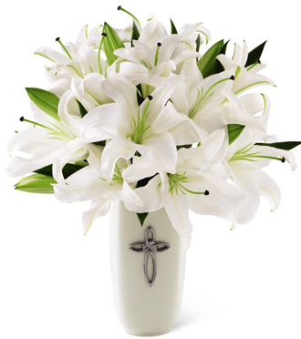 White lilies in a keepsake vase delivered for sympathy to a funeral home or home by local Grand Rapids florist, Sunnyslope Floral