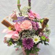MOTHERS DAY ARRANGEMENT IN A BASKET WITH CANDY BARS