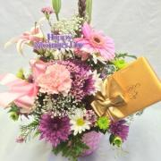 MOTHERS DAY ARRANGMENT IN BASKET WITH CHOCOLATES