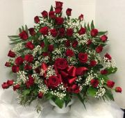 Red Roses and Babies Breath Arrangement