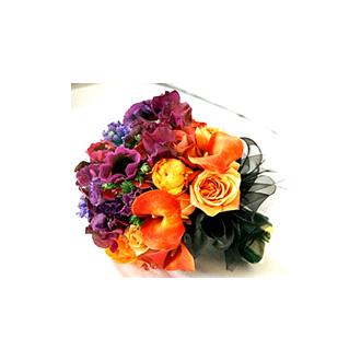 Vibrant Clutch, callas, roses, ranunculus, lisianthus, bridal bouquet