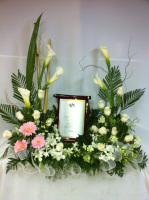 Urn with Plaque ( Supplied )