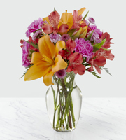 Lighten up someone's day up by ordering BEAUTIFUL FLOWERS with Orange, Pink, and Purple colors with Sunnyslope Floral Grand Rapids
