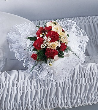 Heart shaped pillow with fresh flowers for a casket can be ordered online or by phone 24/7 with Sunnyslope Floral, your same day delivery specialists