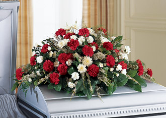 Red and white sympathy casket spray flowers for delivery in Grand Rapids, Grandville, Rockfrod, Holland, Zeeland and Walker by Sunnyslope Floral