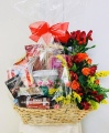 With Sympathy Fruit and Sweets Basket