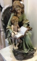 Angel with reading child statuary