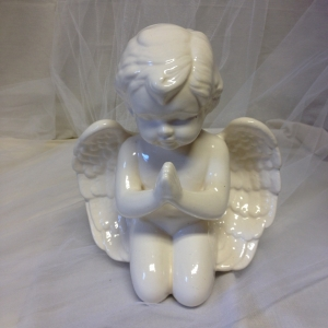 White ceramic praying angel