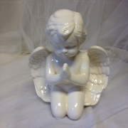 White ceramic praying angel