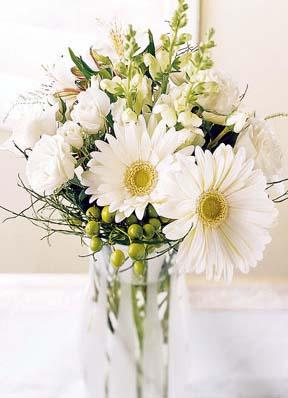 White flowers in a vase vase and cellar image avorcor florist cream and white flowers in a vase miles for style mightylinksfo