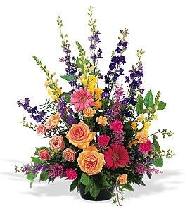 Colorful sympathy spray flowers and other gift ideas for same day delivery to funeral homes in Grand Rapids, Rockford, and Byron Center by Sunnyslope Floral