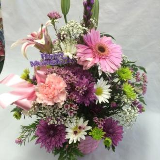 MOTHERS DAY ARRANGMENT IN A BASKET