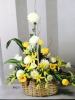 sympathy yellow and white basket arrangement