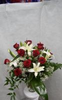 red roses with white lillys