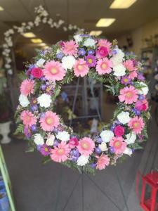 FUNERAL WREATH IN PINKS PURPLE AND WHITE