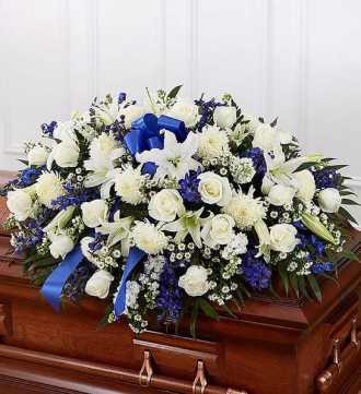blue and white casket spray