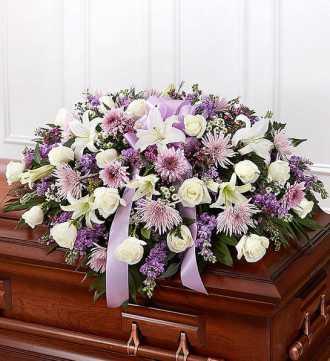 lavender and white casket spray