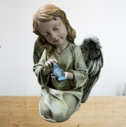 Angel Holding Bird