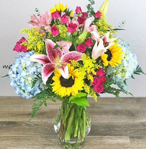 Large Vase Featuring Sunflowers and Lilies