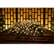 White Rose Memorial Casket Floral Arrangement