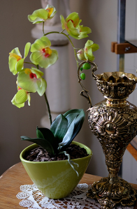 ARTIFICIAL GREEN ORCHID IN A LITE GREEN VASE