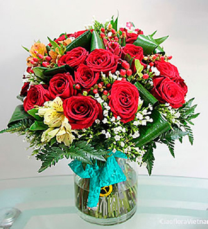 Red Roses and Seasonal Flowers in a Vase
