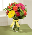 Bright mix of gerbera daisies, roses, carnations, mums and fillers.