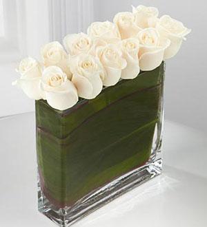 Le Bouquet Eloquent™ des Roses Blancs de FTD®