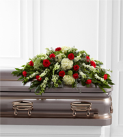 Red and white casket spray flowers for same day delivery to funeral homes in Grand Rapids, Michigan, in Canada and world wide with Sunnyslope Floral